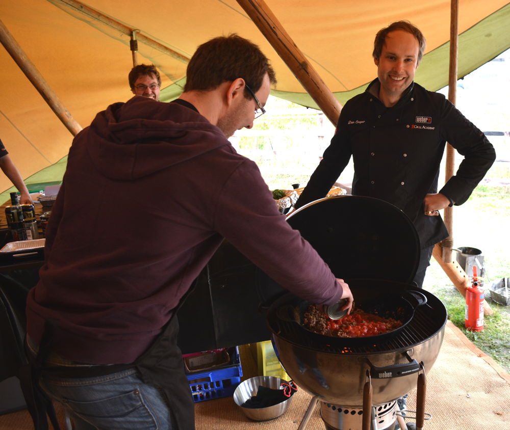 Tom making chilli con carne on the weber barbecue